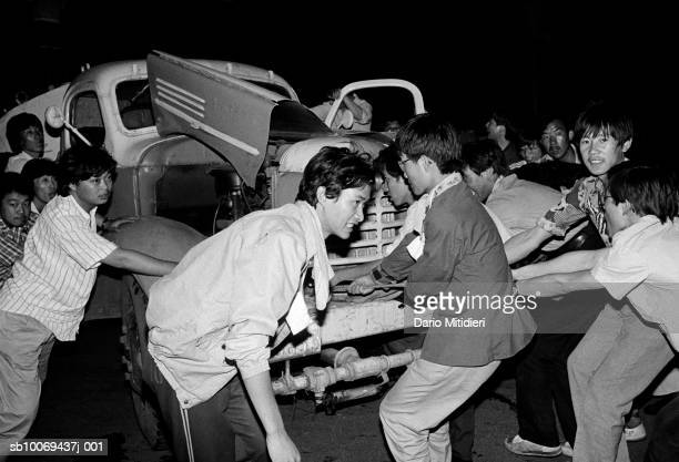 1989 Beijing China Democratic protesters drag a wrecked truck to form a barricade against the Chinese army entering Tiananmen Square in Beijing in...