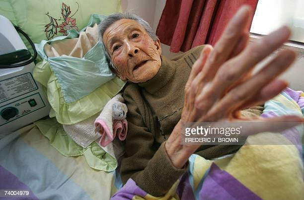 Eightynine year old Wang Min lays bedridden in a retirement home for the elderly on the outskirts of Beijing 27 April 2007 China's Social Security...