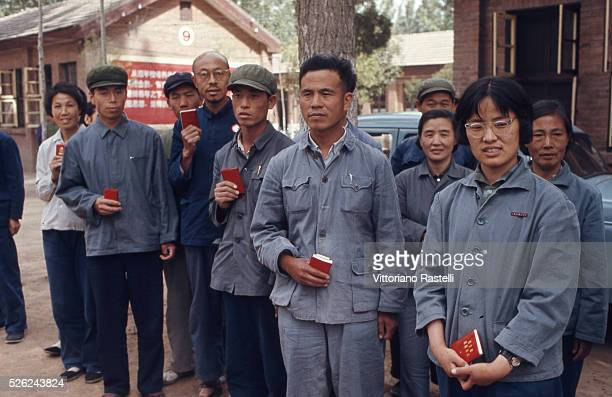 Beijing China Factory workers hold Mao Zedongs Red Book in Beijing May 21 1971