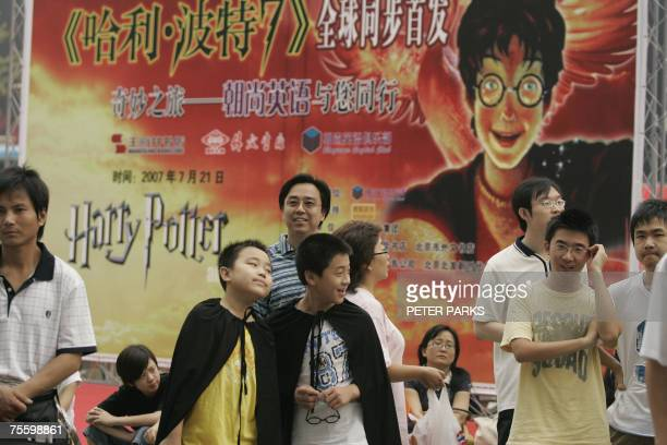 Fans wait outside a bookstore for the final instalment of the Harry Potter seris 'Harry Potter and the Deathly Hallows' in Beijing 21 July 2007...