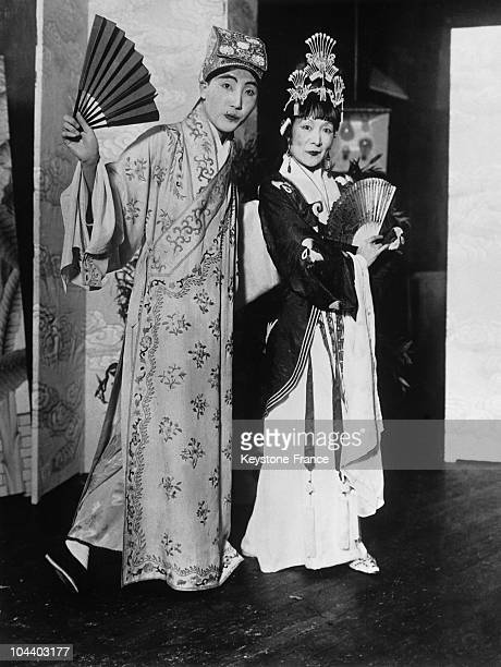 Beijing China Former ladyinwaiting to late chinese empress wear ancient court costume at Beijing charity ball Right Princess DANPAOCHAO as she...