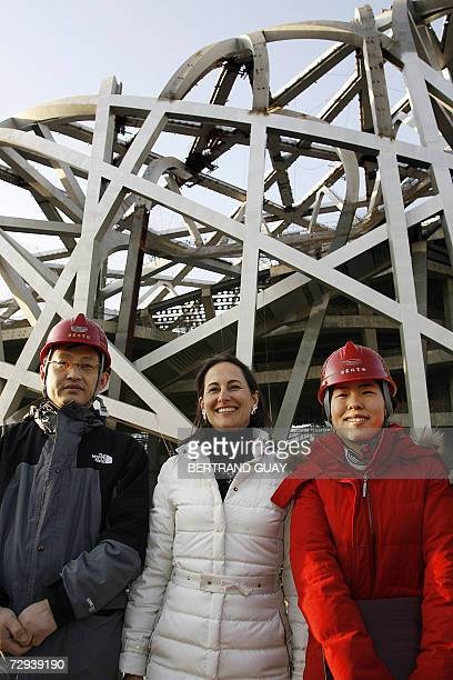 French Socialist Party presidential candidate Segolene Royal poses for a photo with Yuan Quan deputy General manager and Zhang jin during a visit to...