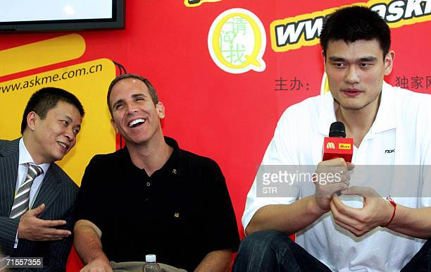 McDonald's vice president Gary Rosen shares a light moment with CEO of Chinese portal Sinacom Zhou Guowei as they sit together with China's...