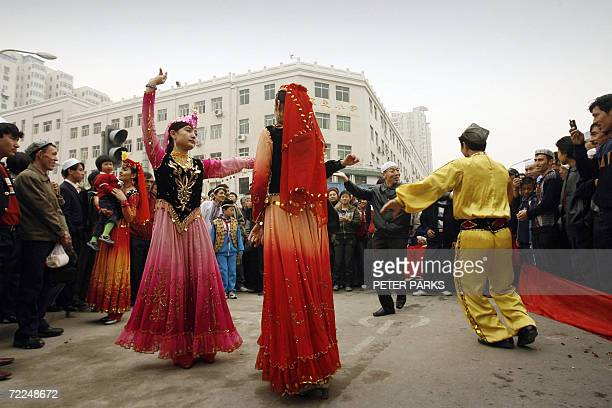 Muslim men and women dance to celebrate EidalFitr marking the end of the monthlong Ramadan fast outside the Niujie Mosque the largest in Beijing 24...