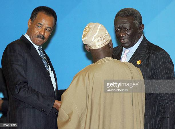 Nigerian President Olusegun Obasanjo chats with Ghanaian President John Agyekum Kufuor and President of Eritrea Isaias Afewerki after a group photo...