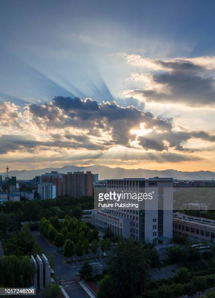 "Beijing, China, on the evening of August 15, 2018. The ""ladder of God"" in the sky, also known as the ""light of Jesus"", is called the Tindal effect or..."