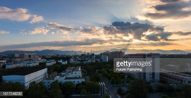 """Beijing, China, on the evening of August 15, 2018. The """"ladder of God"""" in the sky, also known as the """"light of Jesus"""", is called the Tindal effect or..."""