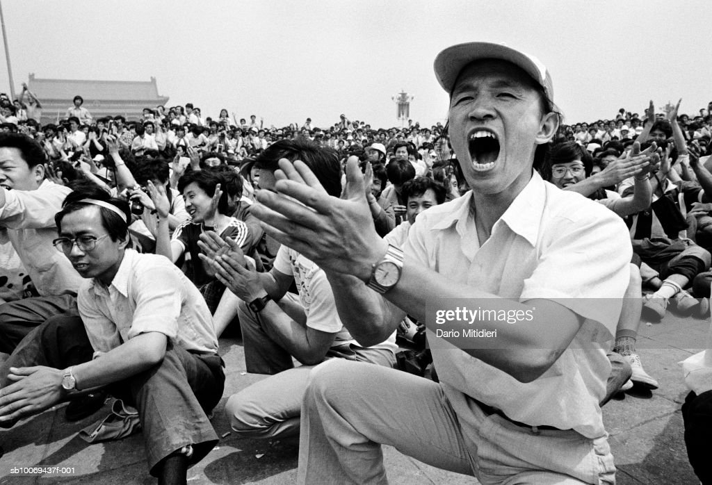1989, Beijing, China, People applauding the unveiling of the pro-democracy statues in Tiananmen Square just a few days before the massacre which took place on the 3rd and 4th of June, 1989.