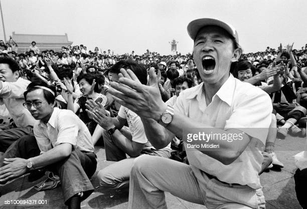 1989 Beijing China People applauding the unveiling of the prodemocracy statues in Tiananmen Square just a few days before the massacre which took...