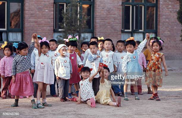 Beijing China School children holds Mao Zedongs Red Book during an essay in Beijing May 21 1971