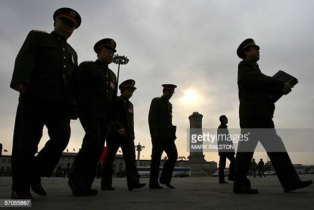 Senior People's Liberation Army officers walk past the Monument to the People's Hero's as they arrive at the Great Hall of the People before a...