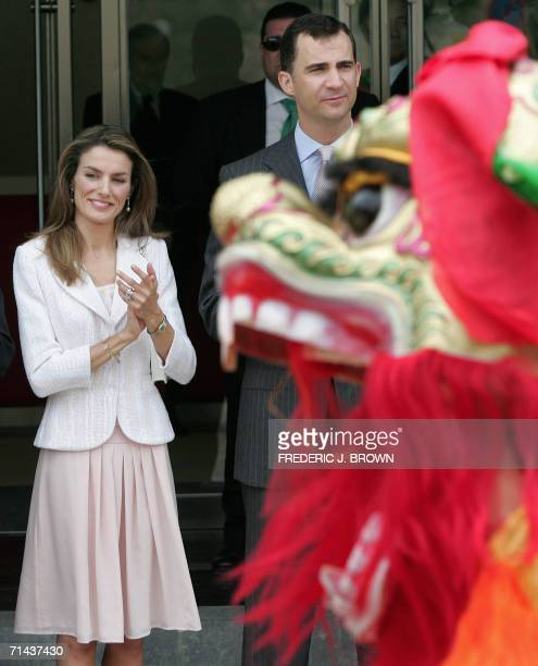 Spanish Crown Prince Felipe and Princess Letizia watch a traditional Chinese lion dance during an inauguration ceremony to mark the opening of the...