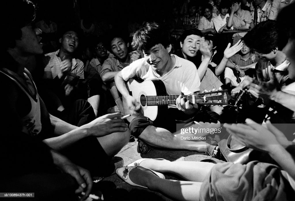 Young man playing guitar during demonstration at Tiananmen Square (B&W)