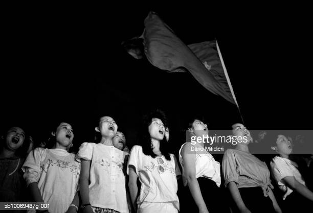 1989 Beijing China Students singing Chinese opera at nightime on Tiananmen Square during peaceful demonstrations for democracy in May just days...
