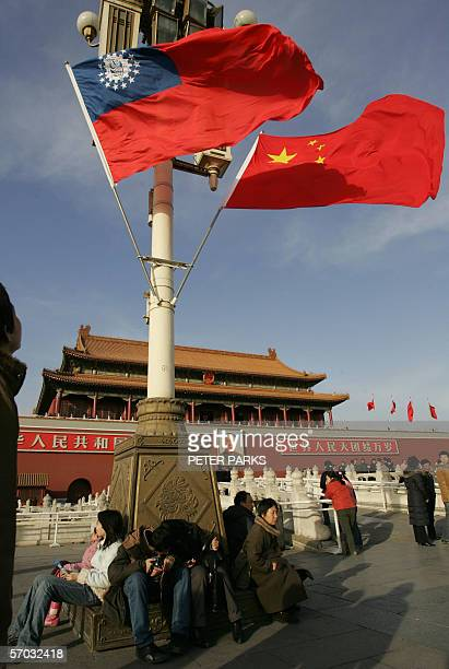 The Myanmar and Chinese flags fly in front of Tiananmen Gate near the Great Hall of the People in Beijing 14 Feburary 2006. Myanmar Prime Minister...