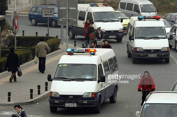 Three police vans arrive at Beijing's High Court before the hearing of Ching Cheong a Hong Kongbased China correspondent for Singapore's Straits...