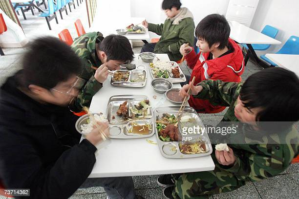 TO GO WITH TechnologyChinahealthaddictionInternet by Peter Harmsen A group of Chinese teenagers eat their meals as they undergo treatment at the...