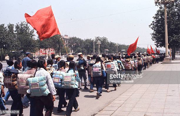 Beijing China Young student march to go to work in the countryside holding red flags on the outskirts of Beijing May 22 1971