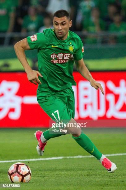 Beijing Guoan forward Burak Yilmaz reacts during the China Super League match between Beijing Guoan and Jiangsu FC at Beijing Workers Stadium on June...