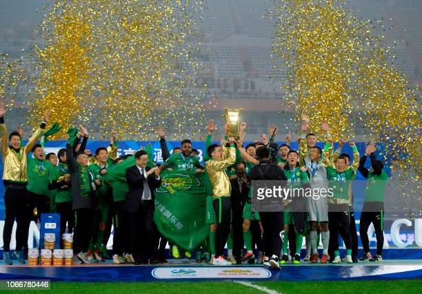 Beijing Guoan players celebrate after winning the Chinese FA Cup final after drawing 22 in the second leg with Shandong Luneng in Jinan in China's...