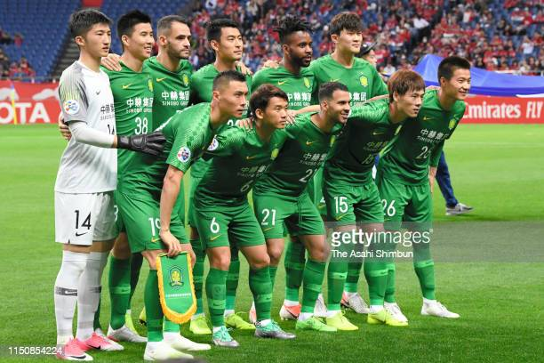 Beijing Guoan players line up for the team photos prior to the AFC Champions League Group G match between Urawa Red Diamonds and Beijing Guoan at...
