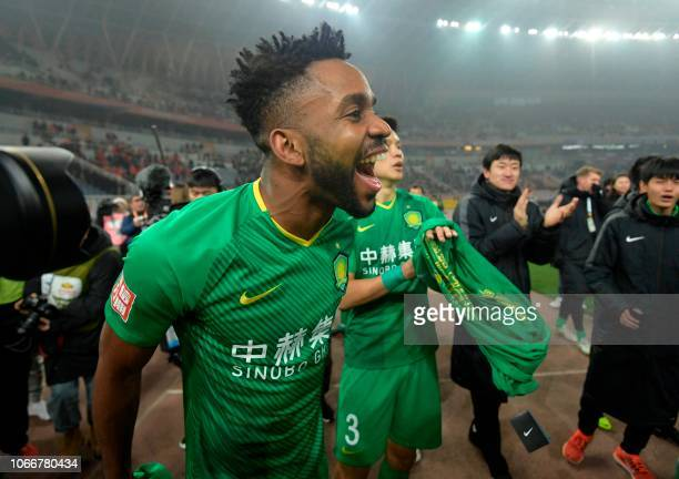 Beijing Guoan's Cedric Bakambo celebrates after winning the Chinese FA Cup final after drawing 22 in the second leg with Shandong Luneng in Jinan in...