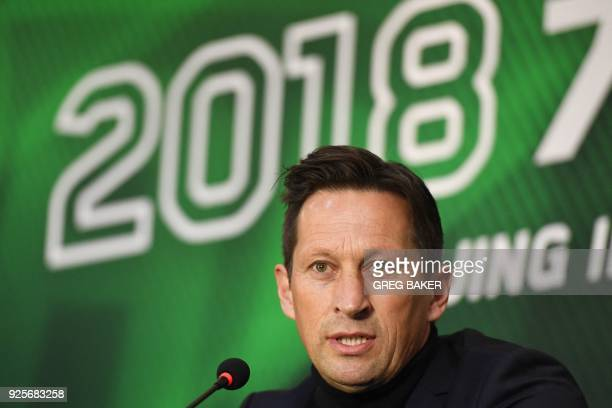 Beijing Guoan's coach Roger Schmidt speaks during a press conference to introduce the team's new football players in Beijing on March 1 2018 Chinese...