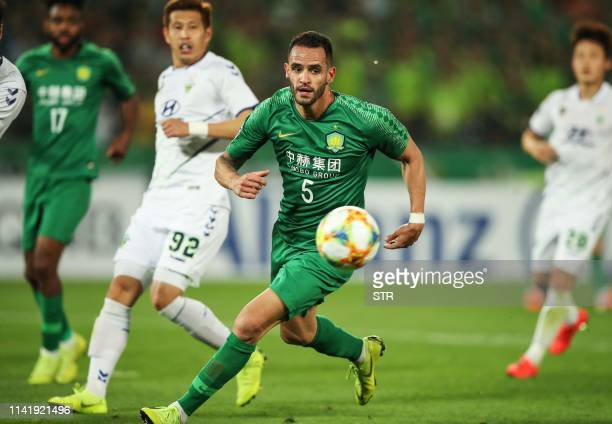 Beijing Guoan's Renato Augusto fights for the ball during the AFC Champions League group stage football match between China's Beijing Guoan and South...