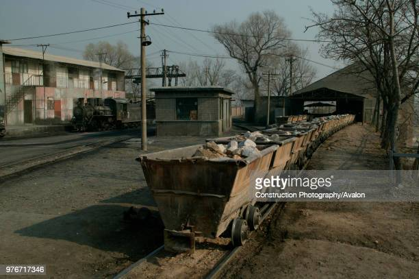 Beijing limestone works on the outskirts of the Chinese capital A rake of wagons is waiting to be emptied into the works hopper for processing whilst...