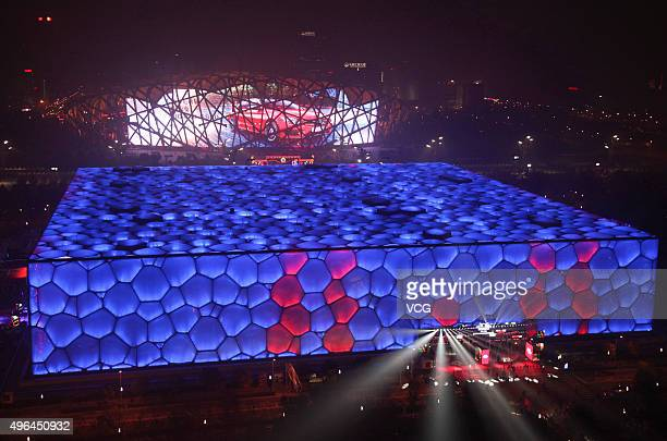 Beijing National Aquatics Center lights up and makes the pattern of 1111 ahead of the 1111 Shopping Festival on November 9 2015 in Beijing China...