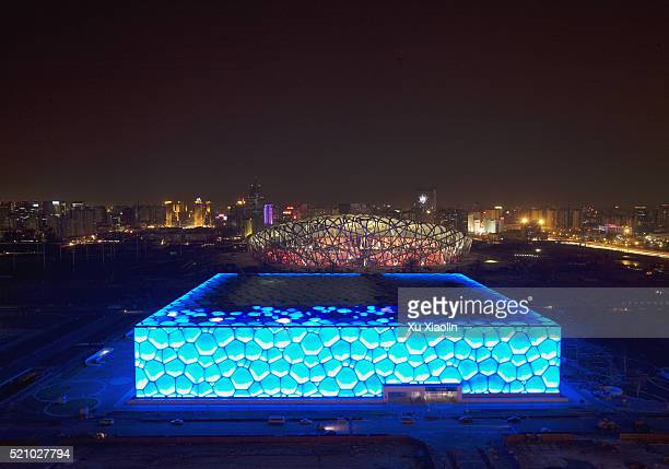 beijing national aquatics centre at night - stadio olimpico nazionale foto e immagini stock