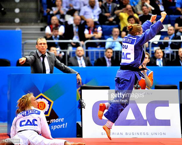 Beijing Olympic gold medallist Alina Dumitru of Romania celebrates a victory after defeating Charline Van Snick of Belgium during day 1 of the...