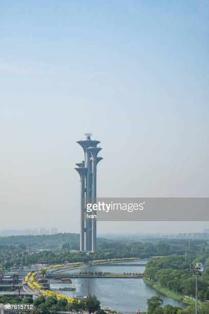 beijing olympic tower against blue sky and river - 国立オリンピック競技場 ストックフォトと画像