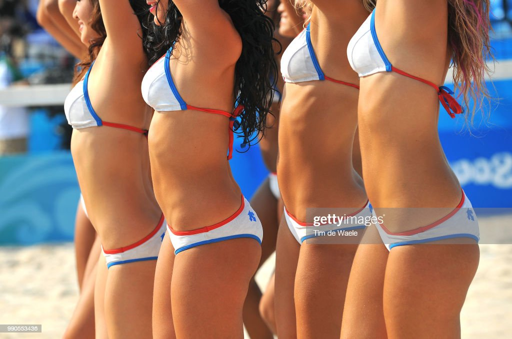 Sexy girls playing beach volleyball