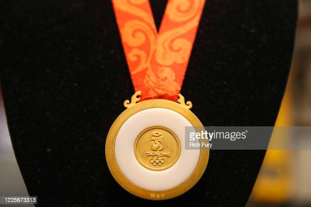Beijing Olympics gold medal in men's football is displayed at a press preview for sports legends featuring Kobe Bryant FIFA and Olympic Medals at...