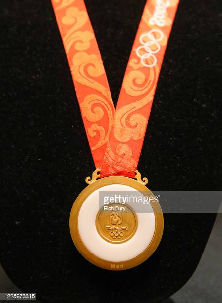 Beijing Olympics gold medal in men's football is displayed at a press preview for sports legends featuring Kobe Bryant, FIFA and Olympic Medals at...
