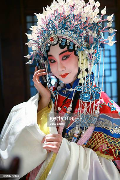 beijing opera actress using phone,china - beijing opera stock photos and pictures