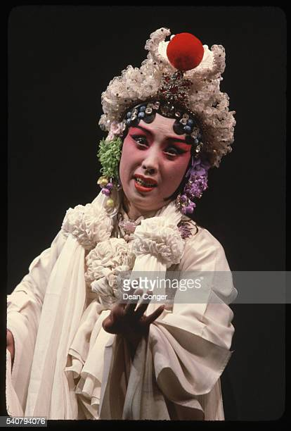 A Beijing Opera singer in an elaborate costume performs in a scene of White Snake Beijing China