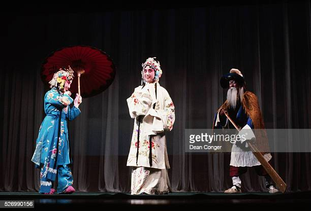 Beijing Opera singers in elaborate costumes perform in a scene of White Snake Beijing China