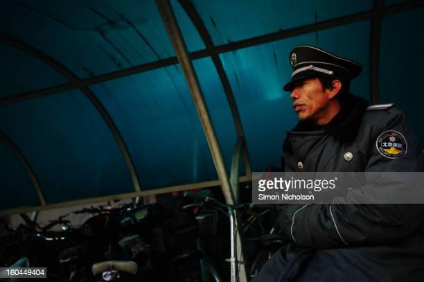 CONTENT] Beijing security worker