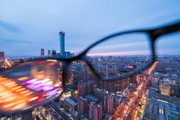 Beijing skyline through glasses