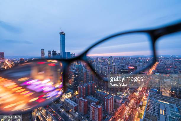 beijing skyline through glasses - partially sighted stock pictures, royalty-free photos & images
