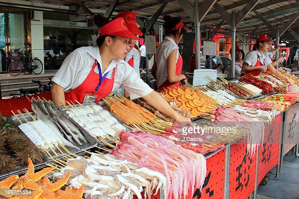Beijing street food market is a famous touristic attraction in China. Visitors can sample typical Chinese food as well as exquisite unusual snacks...