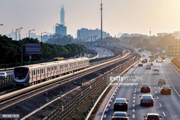 beijing subway and high road - vervoer stockfoto's en -beelden