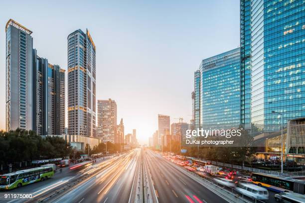 beijing traffic sunset - são paulo stock pictures, royalty-free photos & images