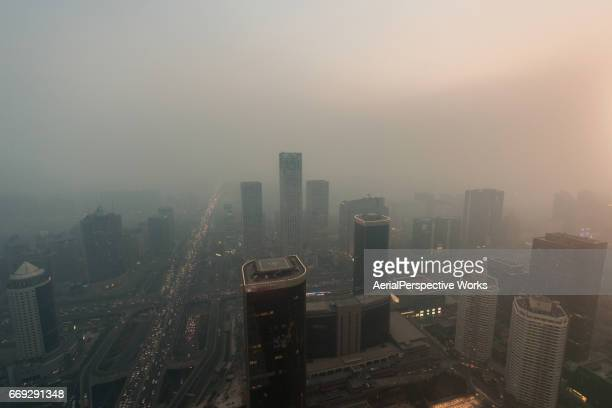 beijing urban skyline in air pollution - smog stock pictures, royalty-free photos & images