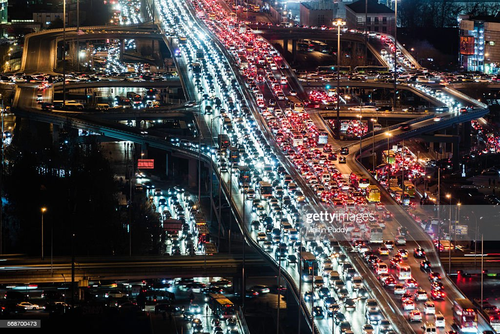 Beijing,road intersection,busy with traffiat night : Stock Photo