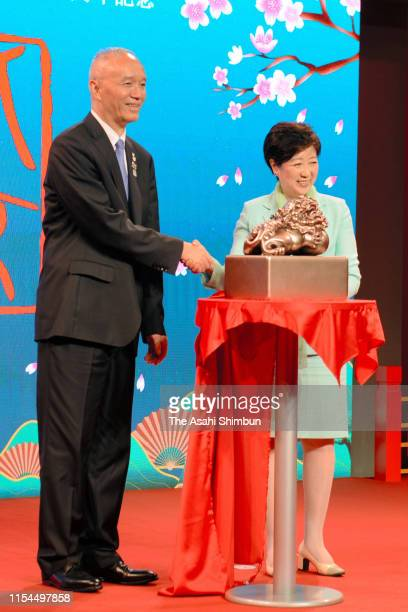 Beijing's Communist Party Secretary Cai Qi and Tokyo Metropolitan Governor Yuriko Koike attend the ceremony marking the 40th anniversary of...