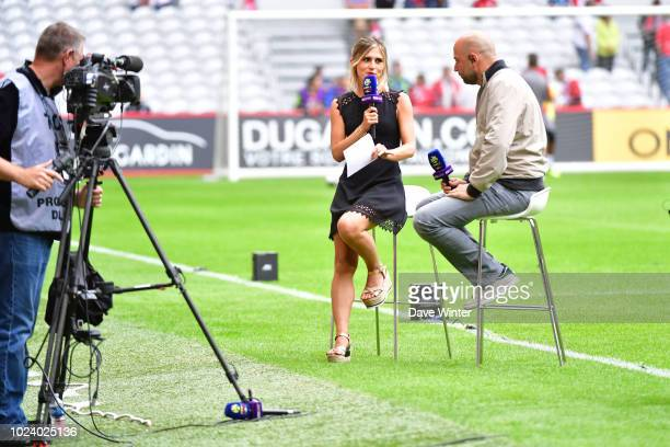 BeIN Sport tv presenter Margot Dumont interviews Lille president Gerard Lopez before the Ligue 1 match between Lille and Guingamp on August 26, 2018...