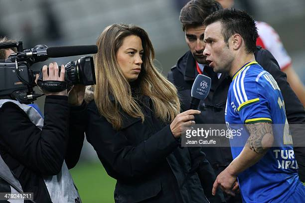 BeIn Sports journalist AnneLaure Bonnet interviews Mathieu Valbuena of OM at the end of the french Ligue 1 match between Stade de Reims and Olympique...